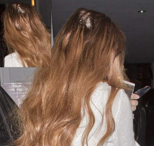 Lindsay lohan s extensions take their toll as she emerges with a bald